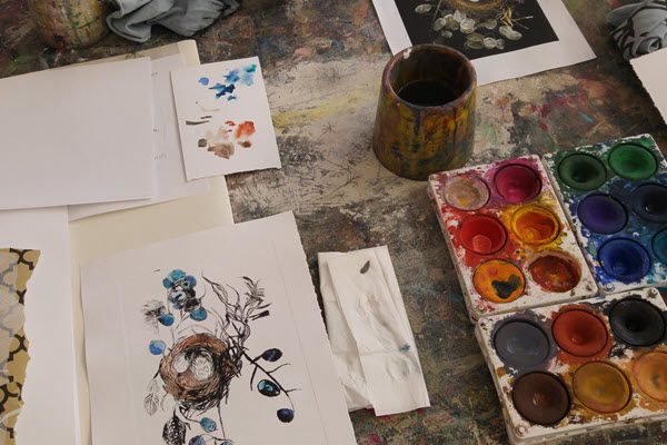 Workshop table with art materials and paints